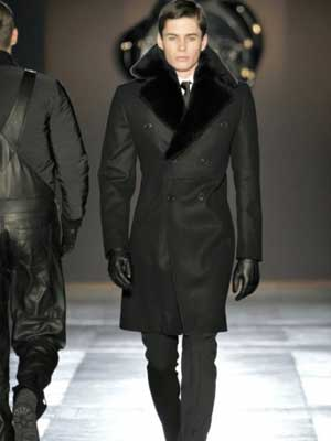 Perhaps he borrowed the look from Victor & Rolf.  (photo courtesy of TheMonsieur.com