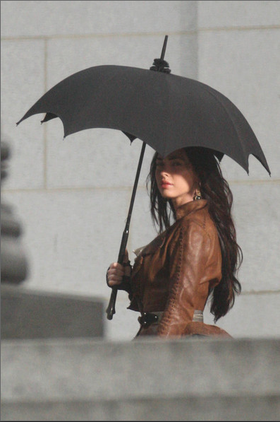 The shape of this umbrella makes Megan's outfit much more interesting, and is the key to her stylish look.